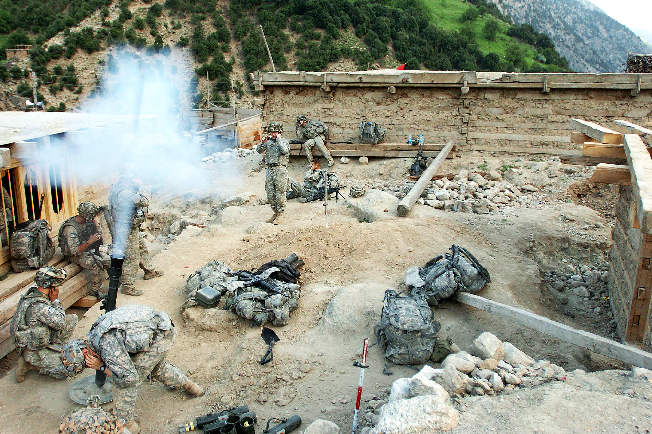 U.S. Army soldiers fire mortar rounds at suspe...