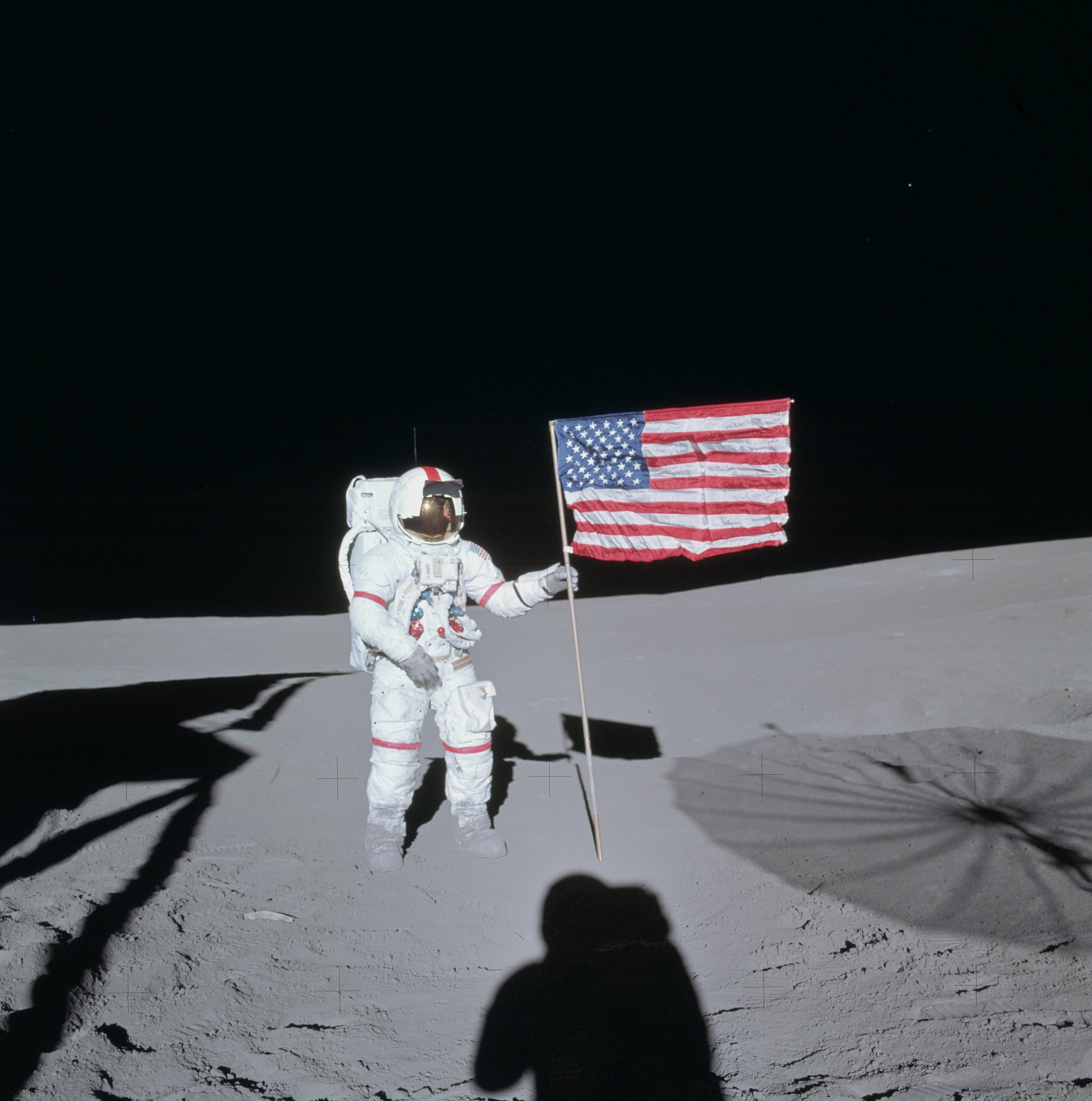 Astronaut from Apollo 14, on the Moon with U.S. flag - NASA photo via Wikimedia