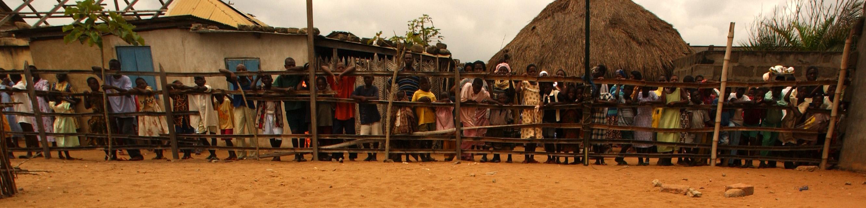 https://i0.wp.com/upload.wikimedia.org/wikipedia/commons/0/09/Ghanians_wait_for_visiting_USN_medics_-b.jpg