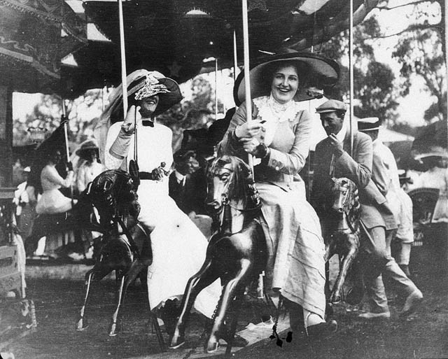 Australian racegoers enjoy a merry-go-round at the Deepwater Races, circa 1910