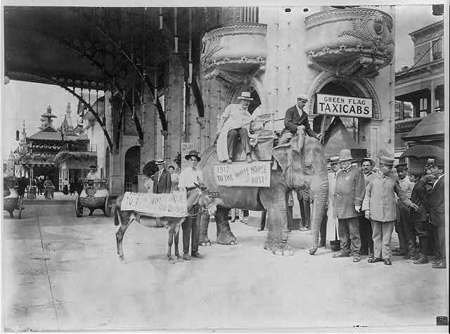 Elephant and donkey in Luna Park, Coney Island, N.Y., prior to race to Washington to decide the bet of Joseph Cannon and Luna Park creator Frederic Thompson. 1911