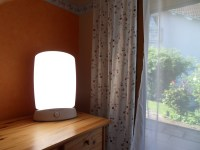 File:Light therapy lamp and sunlight.jpg