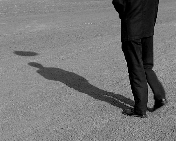 Silhouette of a suited man