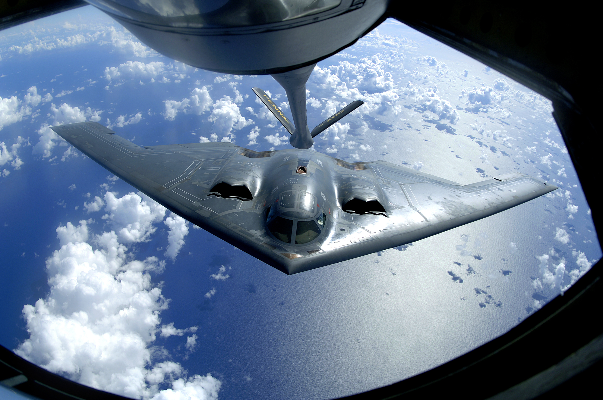hight resolution of a b 2 spirit moves into position for refueling from a kc 135 stratotanker