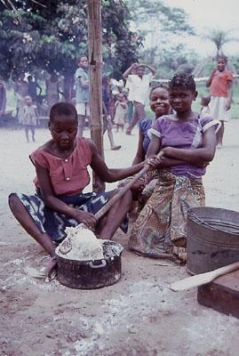 Young women in preparing manioc bread or Fufu....