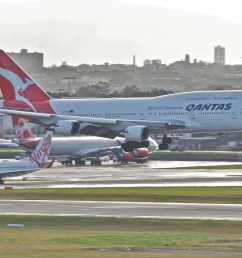 a boeing 747 400er in service with qantas landing at sydney airport [ 2945 x 1971 Pixel ]