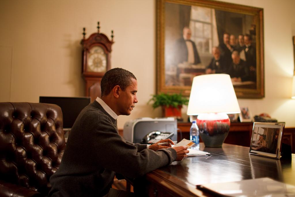 Barack Obama reading a letter