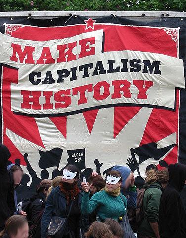 https://i0.wp.com/upload.wikimedia.org/wikipedia/commons/1/17/Make_Capitalism_History_Rostock_1.jpg