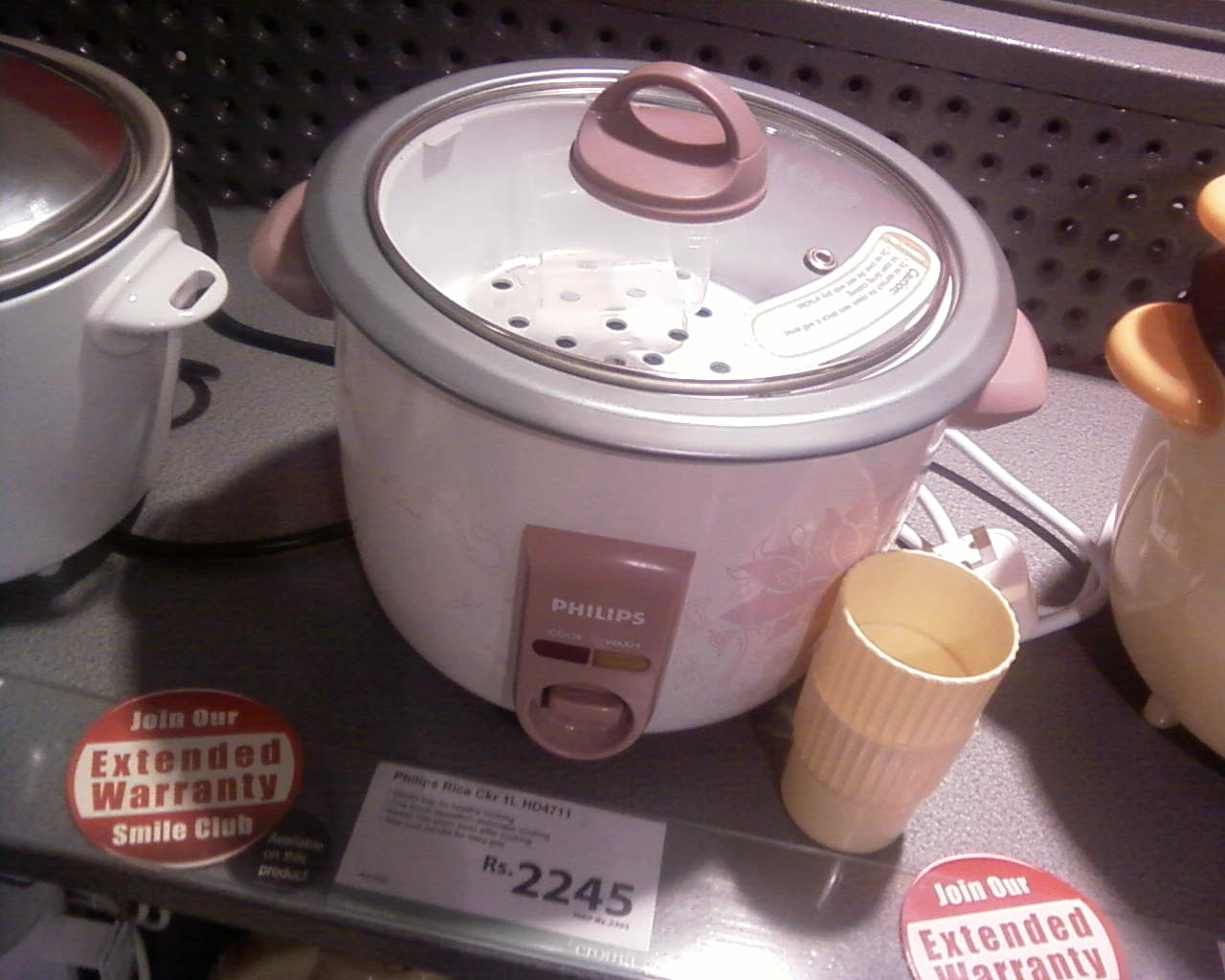 hight resolution of electric rice cooker made by philips in an indian appliance showroom