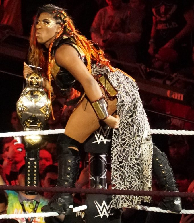 WWE Superstar Ember Moon poses with the NXT Women's Championship.