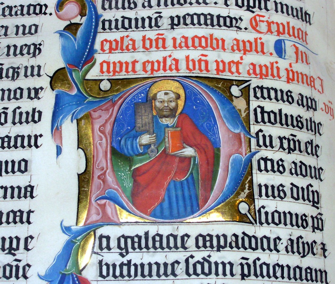 An example of an illuminated manuscript. This example is a close up of the illuminated letter P in the 1407AD Latin Bible on display in Malmesbury Abbey, Wiltshire, England. It was hand written in Belgium, by Gerard Brils.