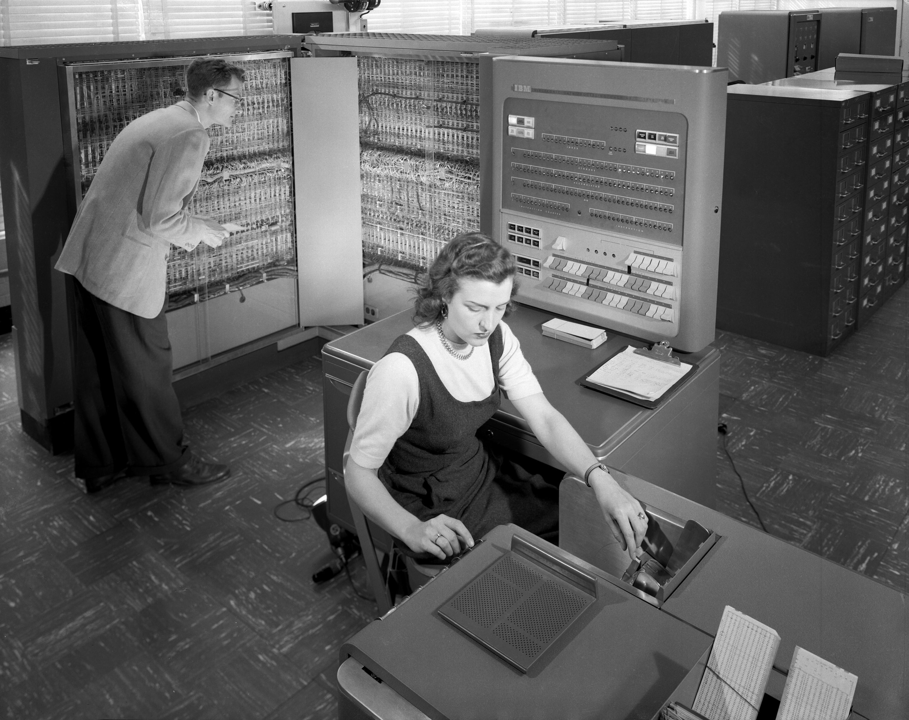 English: Man and woman shown working with IBM ...