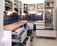 File:White kitchen with cabinet doors and drawers opened ...