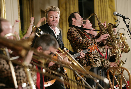 https://i0.wp.com/upload.wikimedia.org/wikipedia/commons/2/27/Brian_Setzer_performs_with_his_orchestra_in_the_East_Room_of_the_White_House.jpg