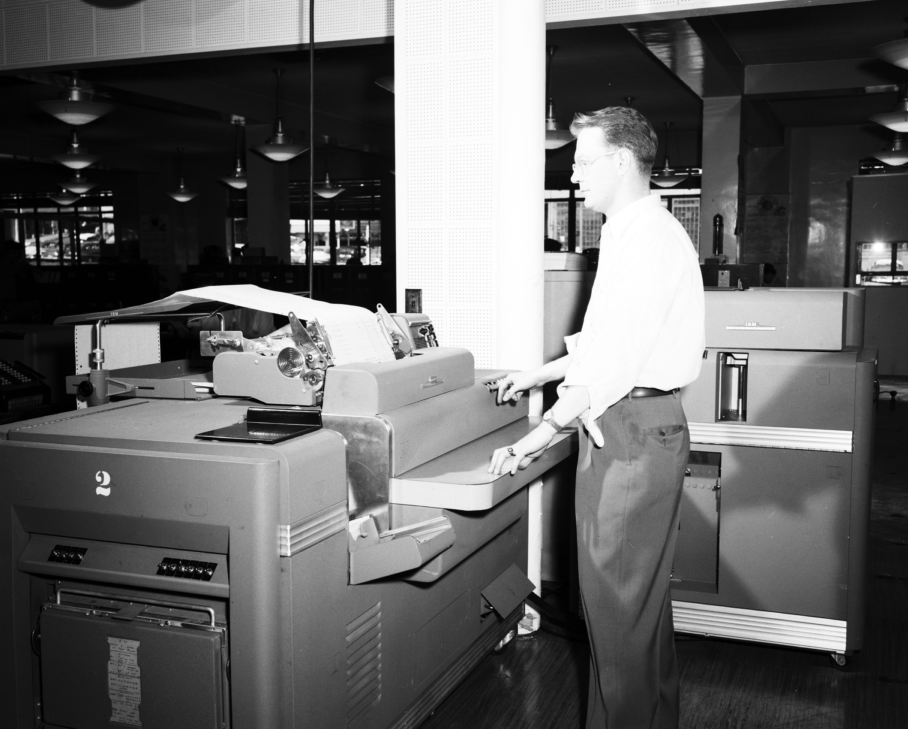 FileSeattle City Light worker with office machine 1954