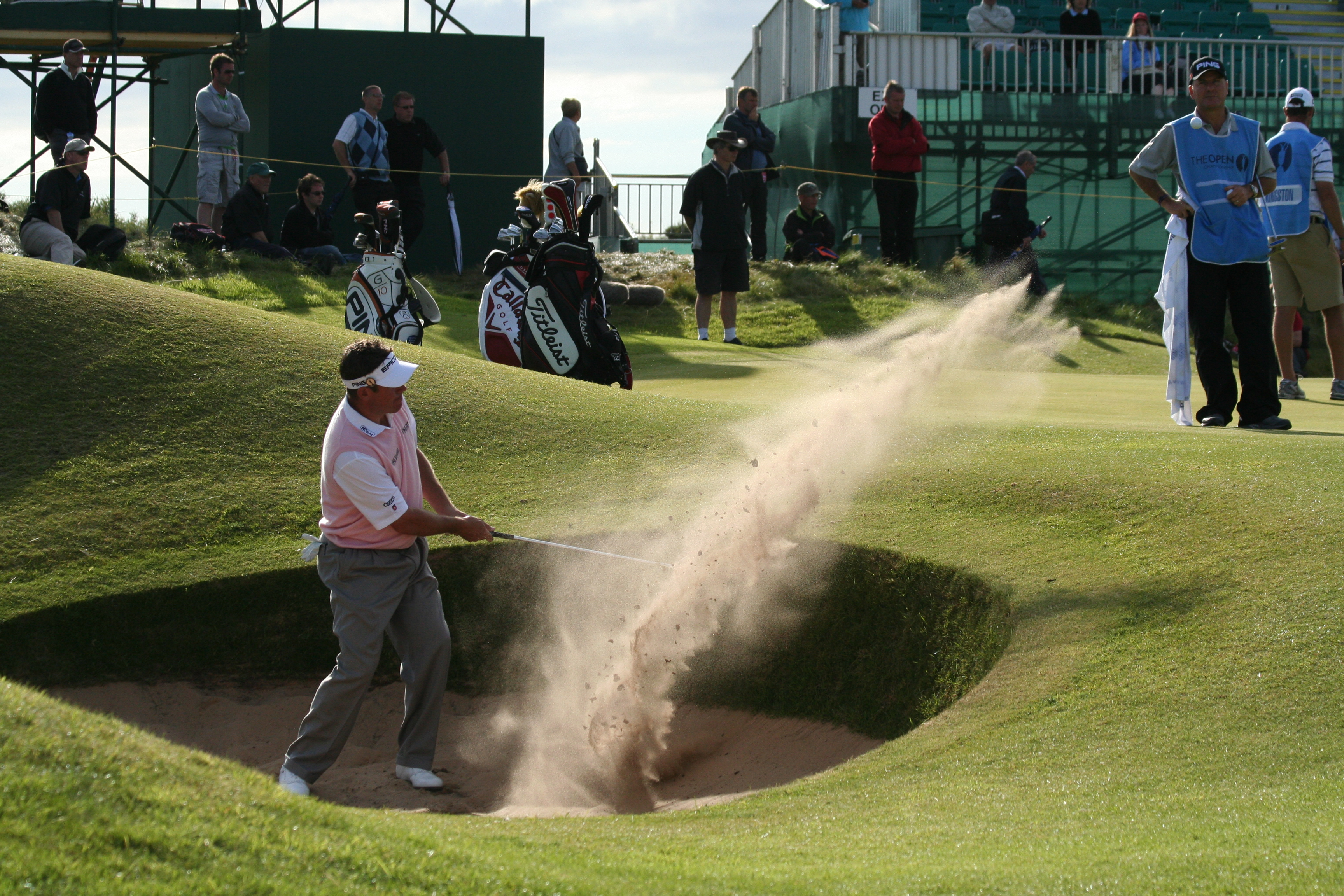 English: Lee Westwood makes a bunker shot at t...