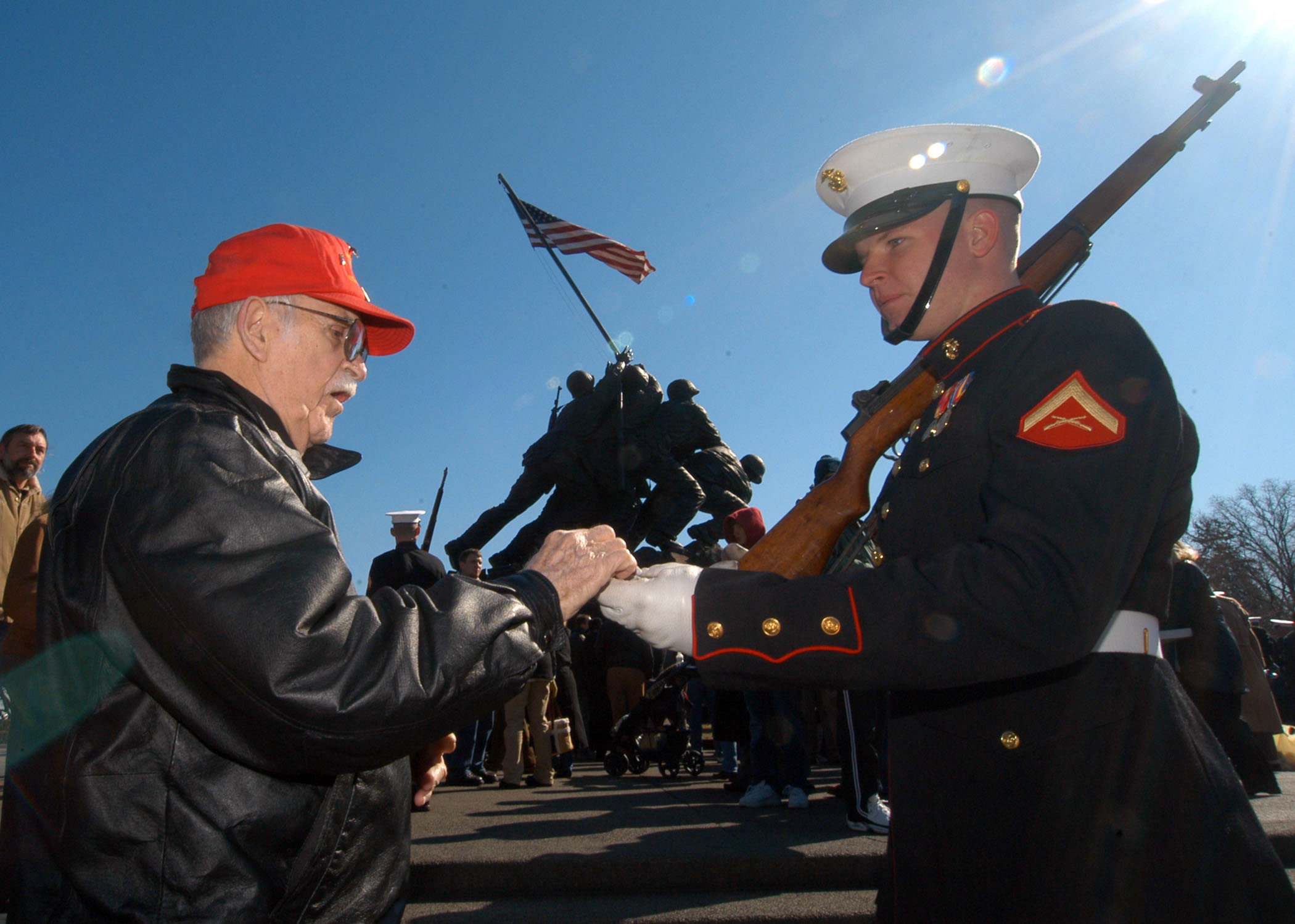 photo of a young Marine and a World War 2 veteran