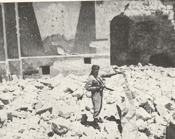 Arab soldier in ruins of Hurva, June 1948
