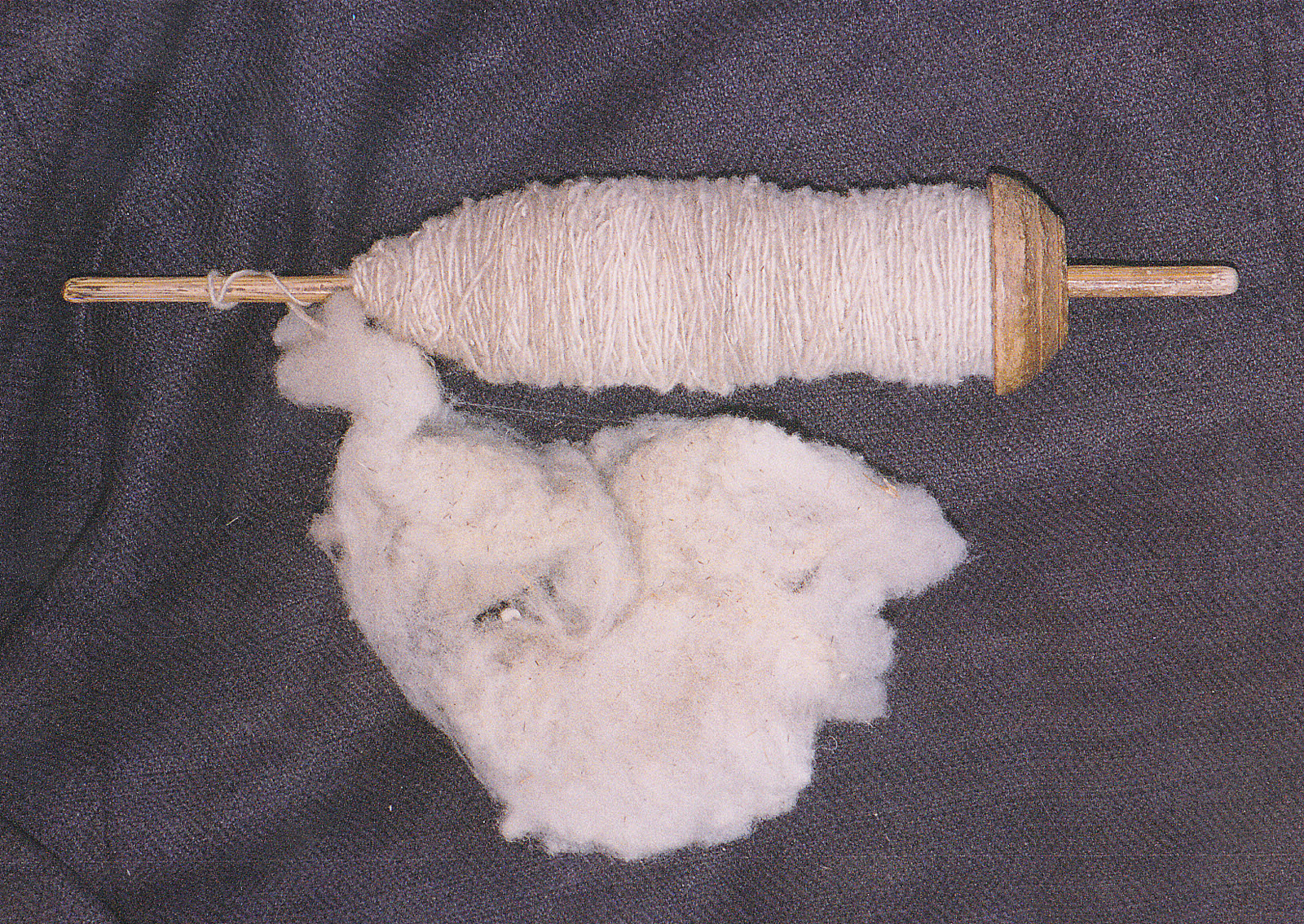 Spindle with alpaca wool
