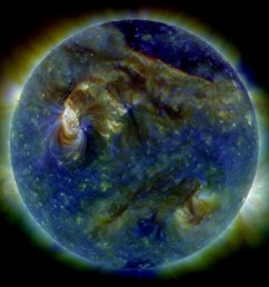 in this false color ultraviolet image the sun shows a c3 class solar flare white area on upper left a solar tsunami wave like structure upper right  [ 4095 x 3647 Pixel ]