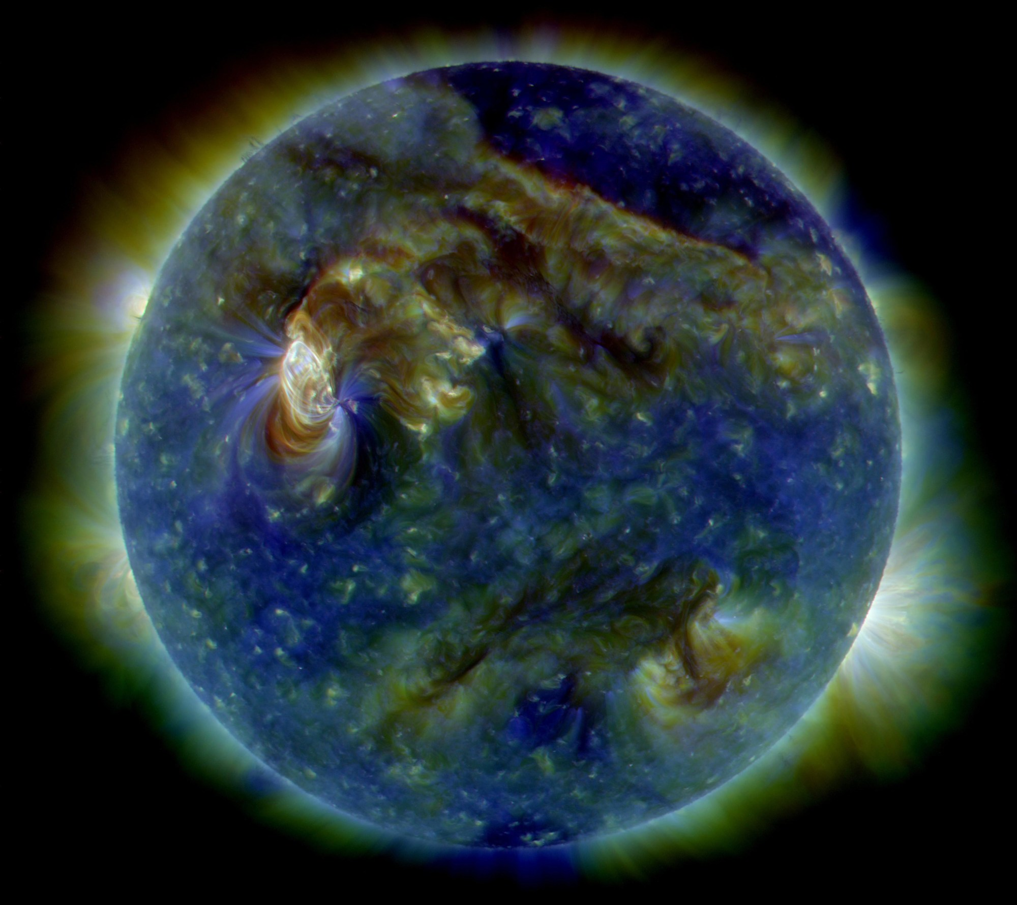 hight resolution of in this false color ultraviolet image the sun shows a c3 class solar flare white area on upper left a solar tsunami wave like structure upper right