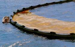 Oil spill containment boom, shown holding back oil