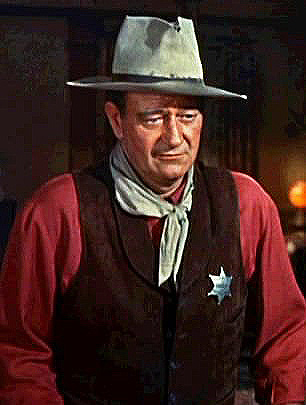 Cropped screenshot of John Wayne and Angie Dic...
