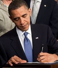 English: English: Barack Obama signing the Pat...