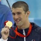 English: U.S. swimmer Michael Phelps shows off...