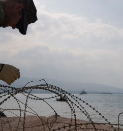 file us navy 100204 n 1134l 109 steelworker 3rd class george sherer assigned to amphibious construction battalion acb 2 installs razor wire around the  [ 1277 x 850 Pixel ]