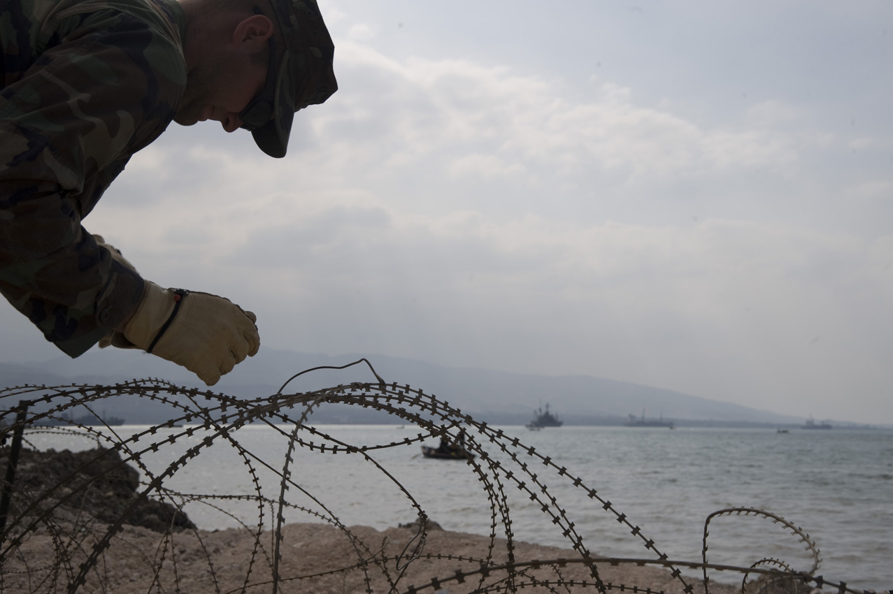 hight resolution of file us navy 100204 n 1134l 109 steelworker 3rd class george sherer assigned to amphibious construction battalion acb 2 installs razor wire around the