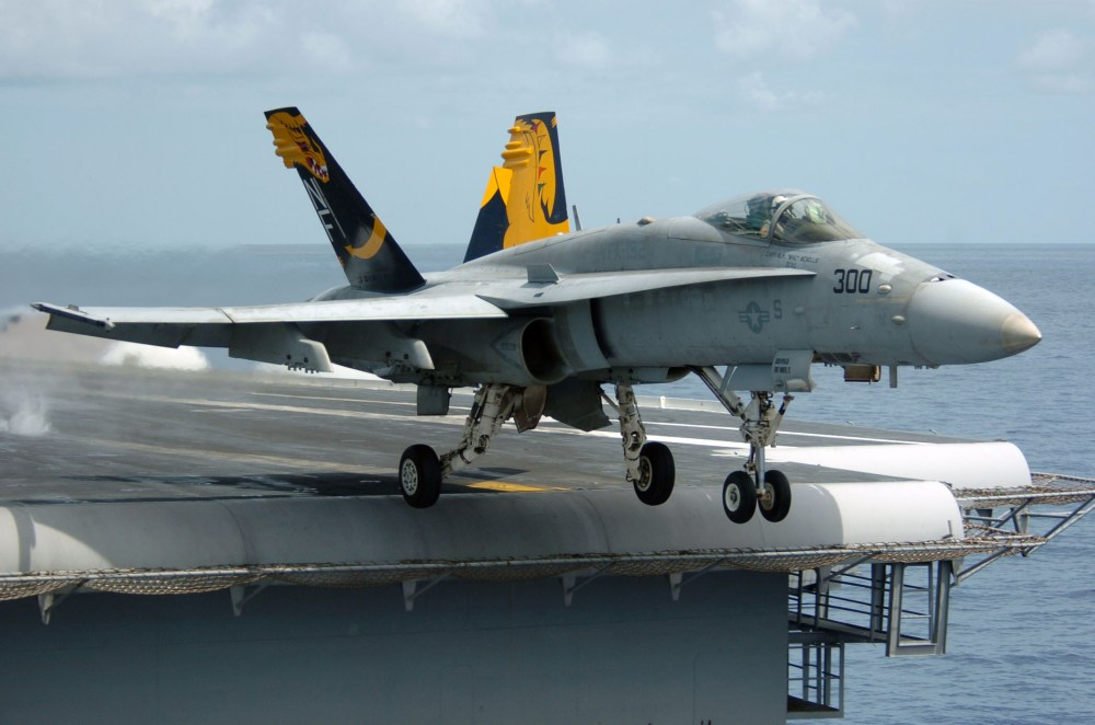 medium resolution of f a 18 hornet fighter departing aircraft carrier a gray overall aircraft