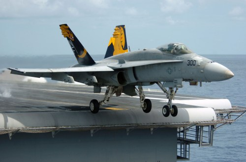 small resolution of f a 18 hornet fighter departing aircraft carrier a gray overall aircraft