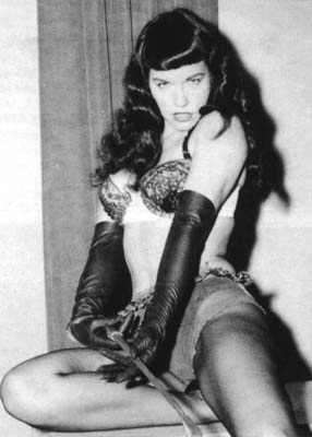 English: Bettie Page with a riding crop