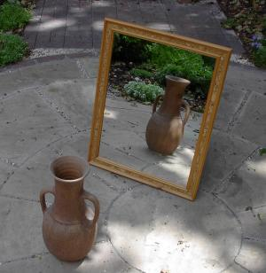 A mirror, reflecting a vase