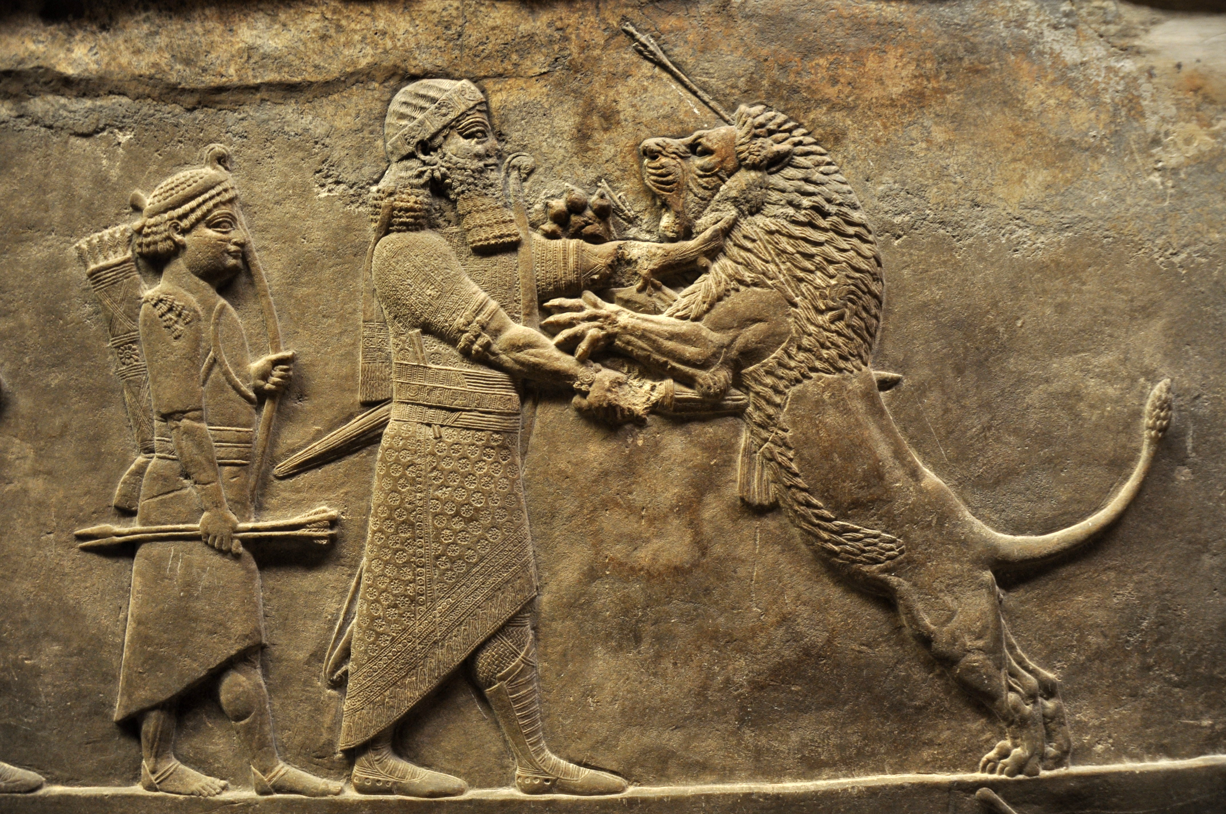 Relief showing king ahur- bani- apli killing a lion by Aiwok, Wikimedia Commons