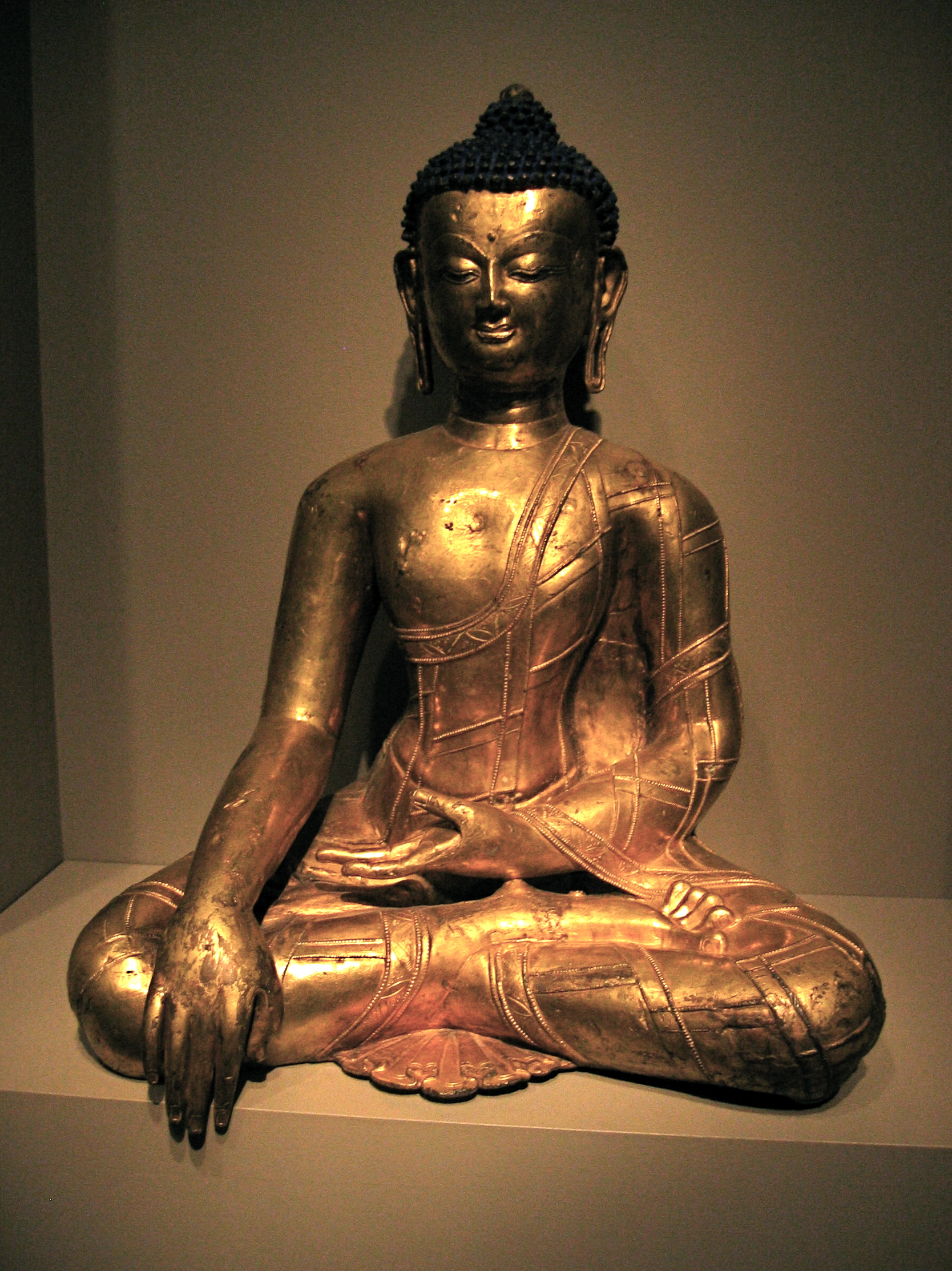 http://upload.wikimedia.org/wikipedia/commons/5/57/Tibetan_copper_statue_of_Gautama_Buddha_(14th_century).jpg