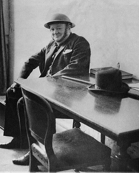 Winston Churchill wearing a helmet during an air raid