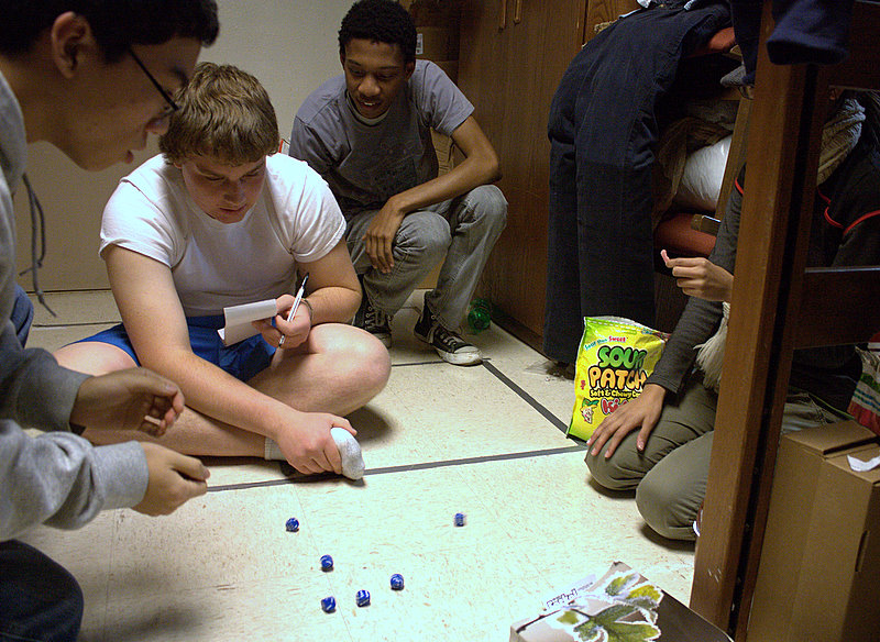 A group of college roommates playing Farkel