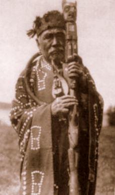 Kwakwaka'wakw tribesman with a talking stick.