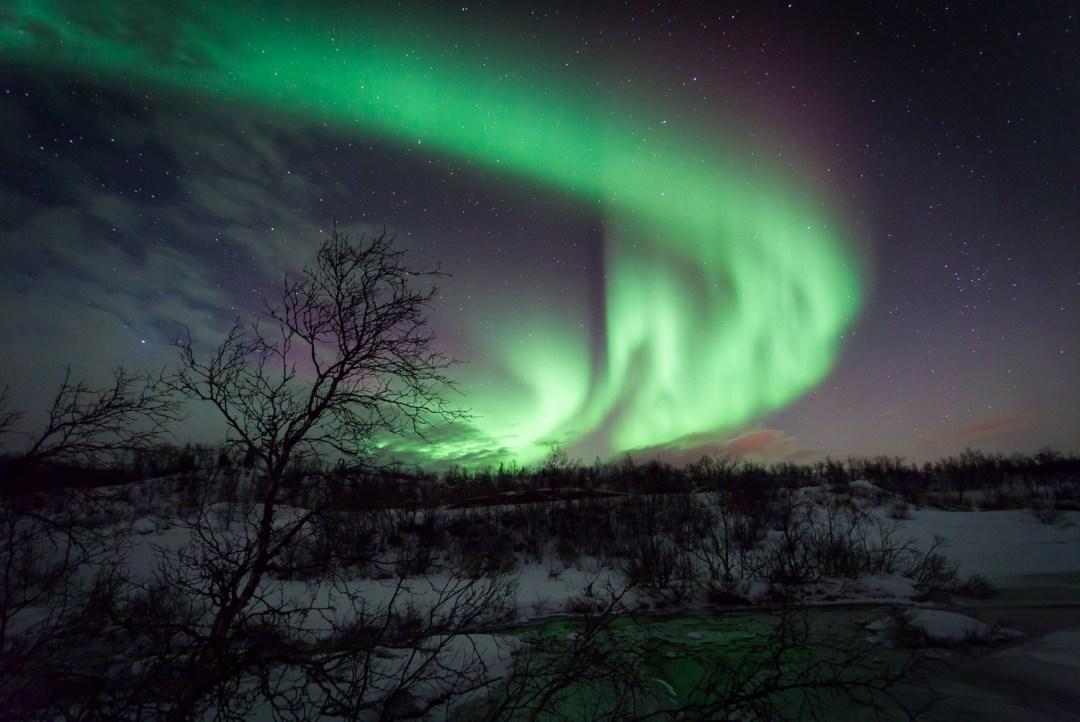 Northern Lights - Aurora Borealis Ringvassøya Tromsø Norway- Most surreal places to visit
