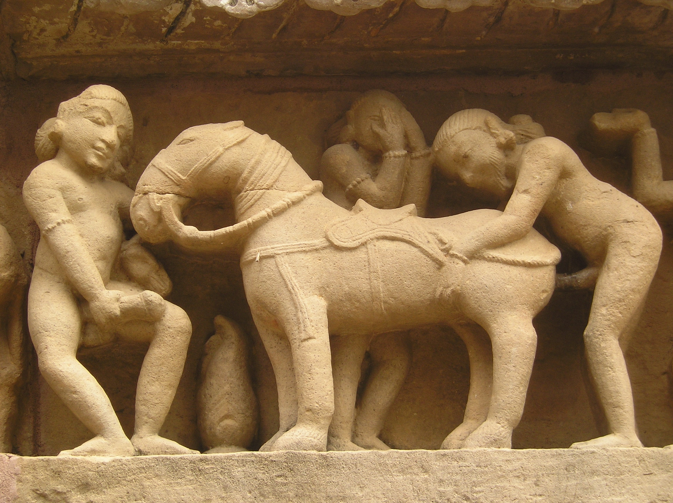 Erotic detal from the base of Lakshana Tempel in Khajuraho (India)