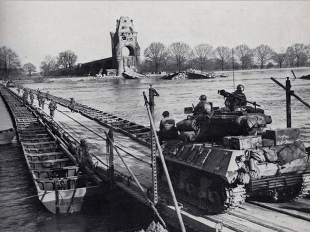 U.S. Army troops cross the Rhine (Remagen) on a heavy pontoon bridge, March 1945