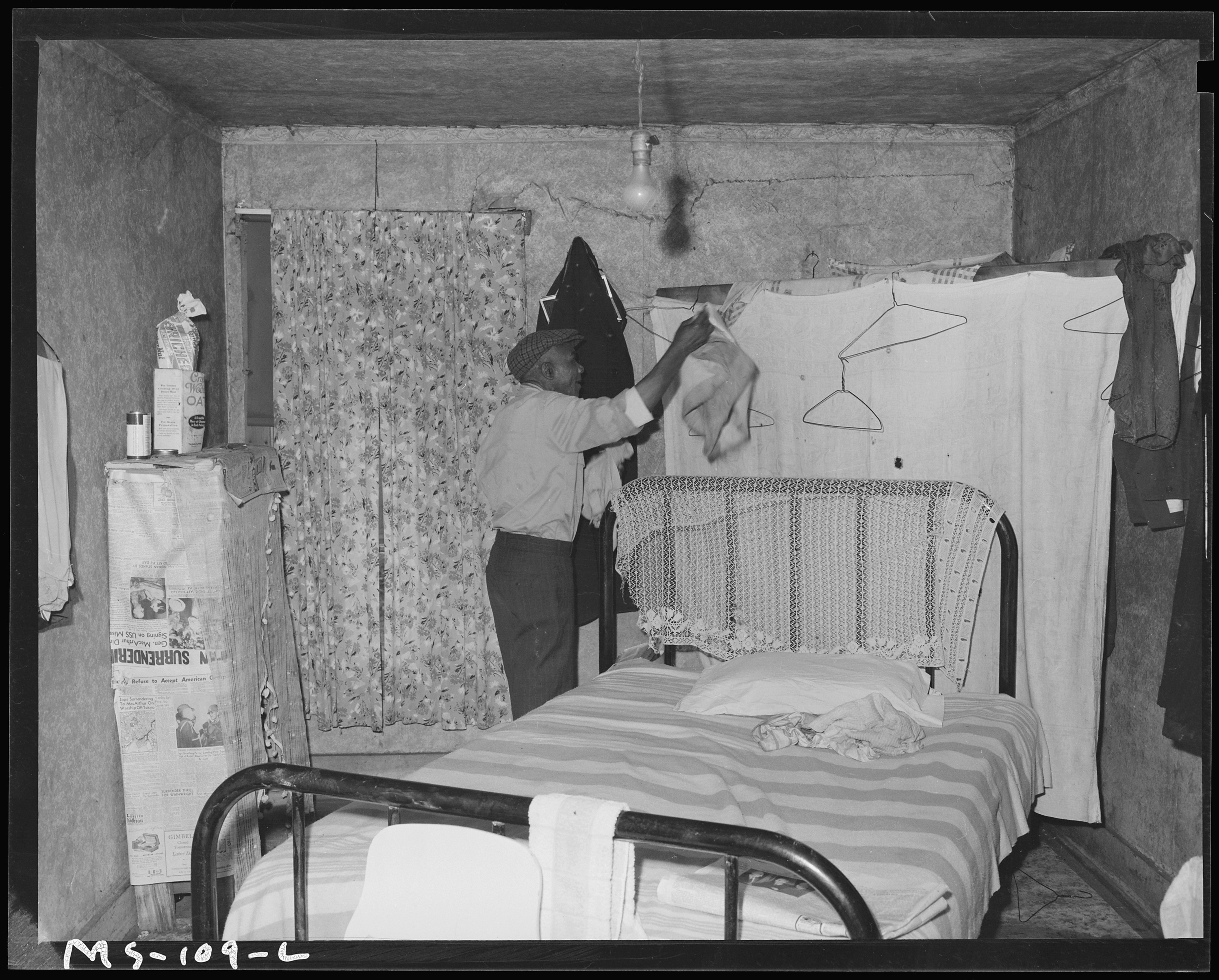 FileAmos Wilson miner in bedroom of his home in company