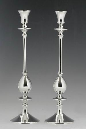 A pair of sterling silver candlesticks for use...