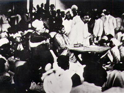 English: Sri Aurobindo presiding over a meetin...