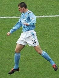 Joey Barton heading a ball during a match