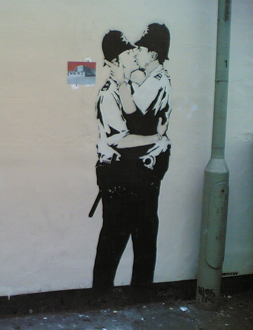 Banksy: Kissing Policemen, stencil graffiti in Brighton, England, by ShoZu.