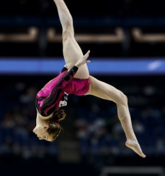 lauren mitchell performing a layout step out on the balance beam  [ 2090 x 3137 Pixel ]