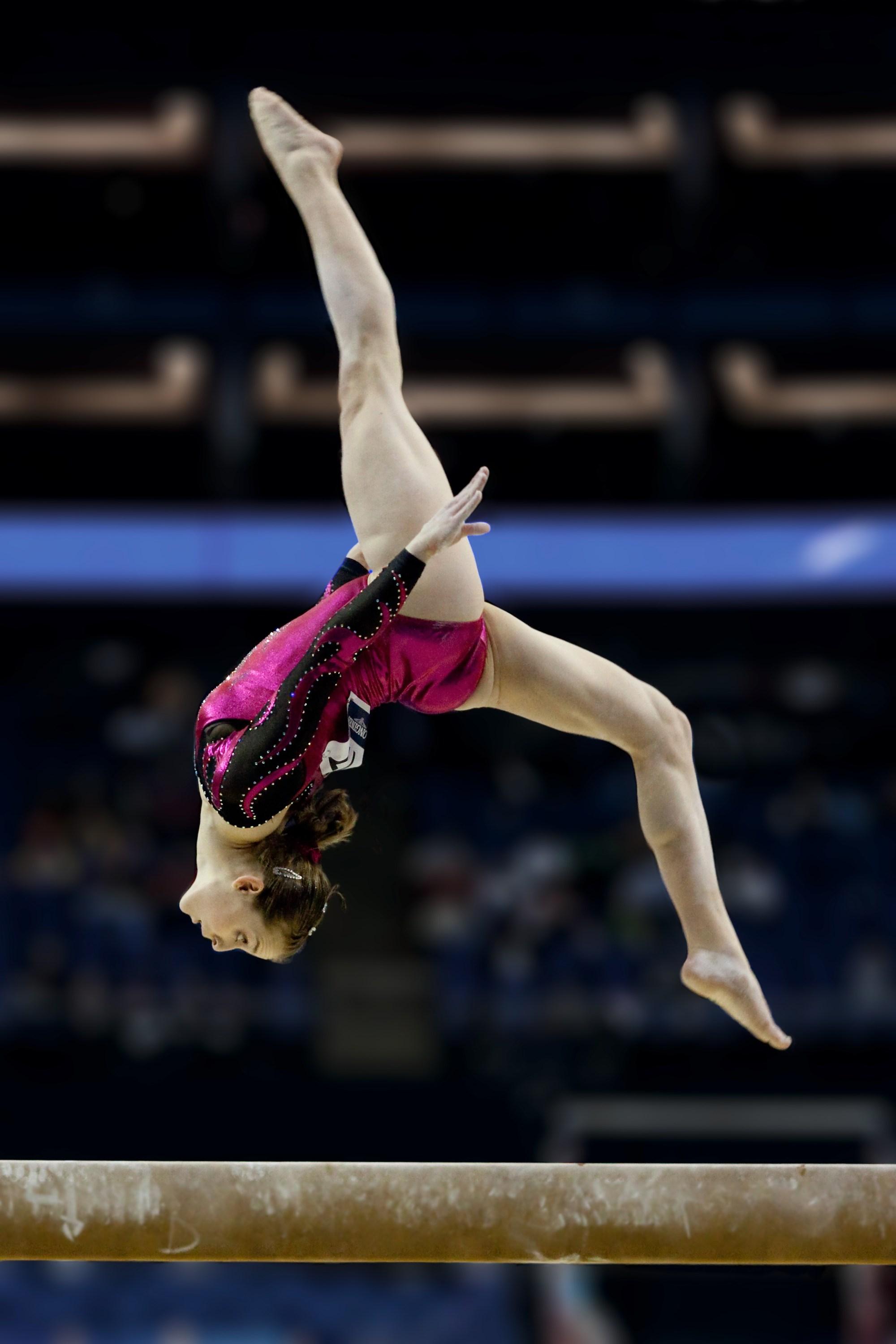 hight resolution of lauren mitchell performing a layout step out on the balance beam